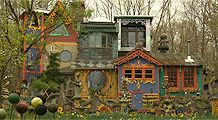 Artist Ricky Boscarino has turned a derelict hunting cabin into a work of art, a complicated, colorful folly of a home.The exterior is chock full of intricate scroll work, multiple colors and structures -- all highly decorated. There's even a clock tower.