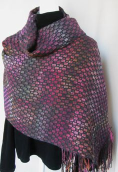 I hand dyed a cotton warp and then wove this wrap in a deflected doubleweave structure. The black outlines in the pattern are wool. Differential