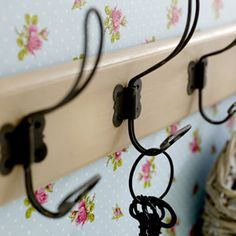 This style of hangers looks very nice! So simple, yet so original! Click he.