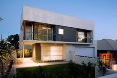 Modern House by Mick Rule, Perth, AustraliaDesigned by Mick Rule, this house is located in Perth, Australia. All living areas are designed to utilize passive solar principles and the mass wal. Suburban House, Ireland Homes, International Style, Home Fashion, Modern House Design, Modern Houses, Prefab, Minimalist Home, Home Deco