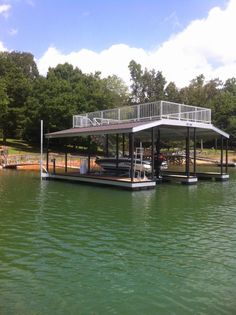 North Georgia Boat Lift & Marine Construction Company completed work on this beautiful CAT 3 dock earlier this week. This dock features a multi-slip for housing multiple boats, and comes complete with a wide side. The main deck, along with the gangway,  features TimberTech Reliaboard decking, whereas the upper deck is equipped with Aluminum Sandstone decking. Custom Wahoo Bumpers line the inside of each slip to protect the owner's vehicle. The upper level is connected by Cantilevered Stairs. House Lift, Boat House, Lakefront Property, Boat Lift, Lake Cabins, Boat Dock, Lake Life, Rustic Design, Dock Ideas