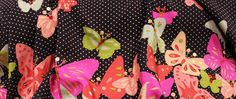 This border print begins three inches from the edge, and the butterflies and polka dots expand 16 inches from there. Shiny sequins within the design add an extra sparkle.