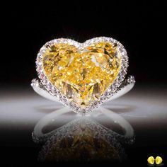 @novelcollectionasia. A heart-shape with captivating yellow color, set in a delicate micro-pave halo to emphasise on that exquisite burst of sunshine! #NovelCollection
