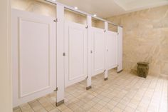 Ironwood Manufacturing laminate toilet partitions and bathroom doors with molding. Beautiful, upscale public restroom stalls.