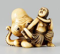 An ivory shunga netsuke of an ama and octopus.