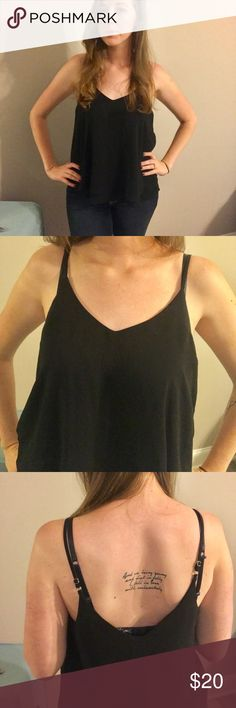 🖤Flirty black tank top😎 This E (hanger) M tank has a v shaped front and back. The hem flows away from the body and is super lightweight material. Anthropologie Tops Tank Tops