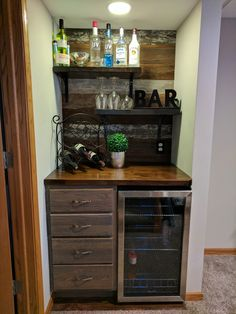 Bar nook: stock cabinet stained gray, butcher block countertop stained dark with the leftovers used as shelves, barn board wall and beverage fridge. Perfect use of a small space. Coffee Bar Home, Home Coffee Stations, Beverage Stations, Mini Bars, Bandeja Bar, Barn Board Wall, Bedroom Storage For Small Rooms, Petits Bars, Home Bar Cabinet