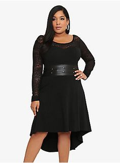 Get ready to WOW your onlookers! This Tripp dress lets you rock a look you're going to totally love. Black lace sleeves. Waistband with studded detail. Hi-low hem. All that's missing from this sexy number is you.