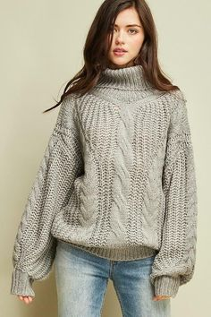 98e795019df Enjoy the classic charm and cozy warmth of this sweater that has a chunky cable  knit design and an elegantly draped turtleneck.