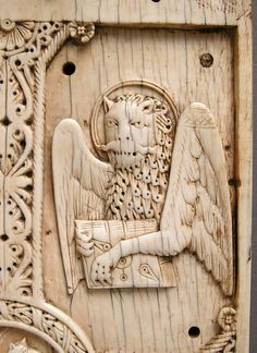 The winged lion, emblem of the Evangelist Mark - Plaque with Agnus Dei on a Cross between Emblems of the Four Evangelists