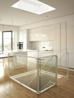 Glass railling with metal white frame. Design oak staircases.