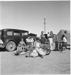 Four families, three of them related with fifteen children, from the Dust Bowl in Texas in an overnight roadside camp near Calipatria, California. March 1937; photo by Dorothea Lange; Dust, Drought, and Depression #10