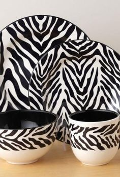 Dress up your dining room table with our Zebra dinnerware collection. #AnnasLinens #AnimalPrint