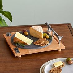 """Designed to look like a record player, the turntable is actually a slate platter. Lift the """"needle"""" and you'll find a hidden cheese slicer. Slate Cheese Board, Cheese Boards, Charcuterie Platter, Gift For Music Lover, Music Lovers, Cheese Platters, Food Platters, Turntable, Tasty"""