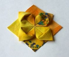 Version of one of Rebecca Wat's Fantastic Folded Flower quilt squares- Tutorial by Crafty Giveaways