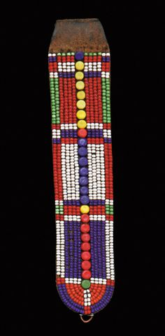 Africa | Beaded Earflap from the Masai people of Kenya | 20th century | Leather embroidered with glass beads and buttons | These types of ear ornaments are worn only by married women.