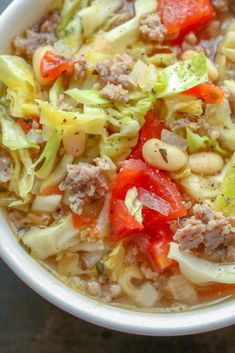 This hearty Italian White Bean, Cabbage, and Sausage Soup is loaded with great flavors and it's filled with far more vegetables and meat than broth. Rib Recipes, Cooking Recipes, Healthy Recipes, Potato Recipes, Vegetarian Recipes, Dinner Recipes, Veggie Recipes, Healthy Meals, Yummy Recipes