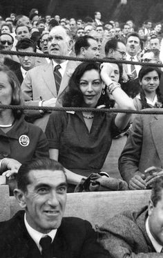 STAND-OUT - Ava Gardner stares at the camera while attending a bullfight in Spain - 1955