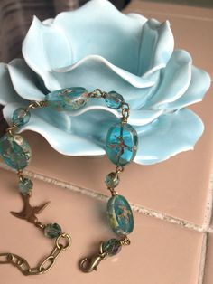 Exquisite! Perfect for Spring!  One of a kind Czech glass pressed beads, in aqua with a swallow design and Picasso finish on the edges, are