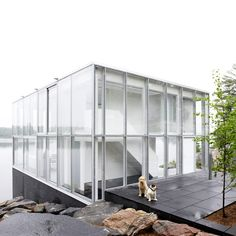 this glass pavilion on the edge of a lake in Ontario, Canada, houses a studio, apartment and boathouse for a photographer and was designed by Toronto Studio. More photos here... http://www.dezeen.com/2012/03/13/photographers-studio-over-a-boat-house-on-stoney-lake-by-gh3/#