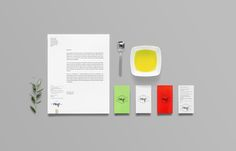 Logo and stationery for olive oil brand Olaf designed by Anagrama