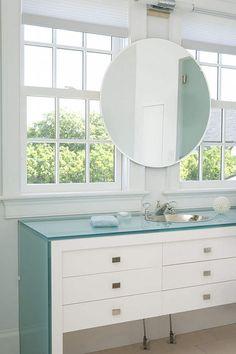 vanity mirror in front of windows