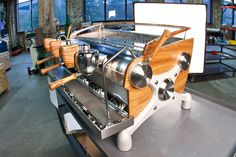 Customized Slayer espresso machine. Love that timber finish.