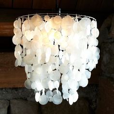 Small Round Capiz Pendant   west elm ... remember to get the $15 conversion kit to hardwire it into the ceiling fixture.