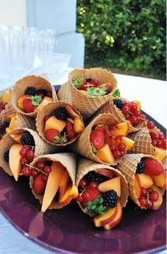 Fruitsalad in icecream cones! If you have the variety with a chocolate coating on the inside, they won't go soggy.