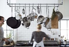 I would love for my someday kitchen to have overhead hooks for easy access to pots, pans and anything else. So lovely!