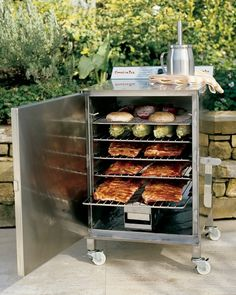 You don't have to visit a Texas ranch to enjoy the flavor of authentic pit barbecue. Using this efficient electric smoker, you can slow-cook beef, pork and poultry to perfection in your own backyard. Bbq Pit Smoker, Diy Smoker, Outdoor Kitchen Design, Outdoor Kitchens, Backyard Kitchen, Backyard Patio, Backyard Pavilion, Backyard Fireplace, Ovens