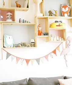 Add storage space to your kid's room with floating shelves.