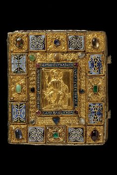 The Sion gospels book cover. Germany (possibly Trier), c. 1140-1150. Beech overlaid with plaques of gold and precious stones, enamelled and with sheepskin undercover.