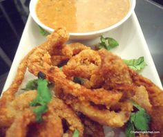 Pan-Asian Fusion Cooking: Lemongrass-Infused Calamari Fritters with a Spicy Peanut Sauce