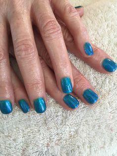 Teal blue shellac gel polish with purple glitter hombre'