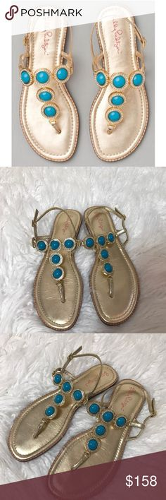 Lilly Pulitzer Set in Stone Sandals These sandals are wonderful! These blue stone Lilly Pulitzer sandals are beautiful in gold. The adjustable buckle strap makes these sandals suitable for all day wear. These sandals will easily go from day to night. Metallic leather, cushioned footbed. Flexible midsole. Leather outsole with a 3/16-inch heel. The sandals come with the printed shoe bag (print varies and may differ from one shown). A great pair of sandals for many occasions! in Brazil; Leather…