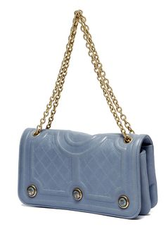 That blue and the buttons.  Handbag by Chanel. Resort 2013