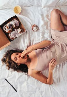 """""""Butter"""" - Lee Price, oil on linen {contemporary figurative realism artist female supine reclining woman eating cinnamon rolls #hyperreal cropped painting #loveart} leepricestudio.com"""