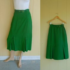 belted green pencil skit with kick pleats . vintage 60s does 40s . small . www.nesteggvintage.etsy.com
