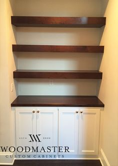 Woodmaster Woodworks custom built ins. Stained shelves & counter top, and custom paint grade cabinets. Beautiful!