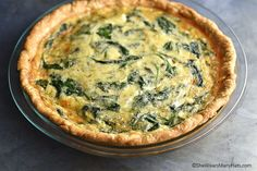 Packed with fresh baby spinach leaves, sautéed onions, creamy gruyere cheese and thyme, this Sautéed Onion Gruyere Spinach Quiche is delicious.