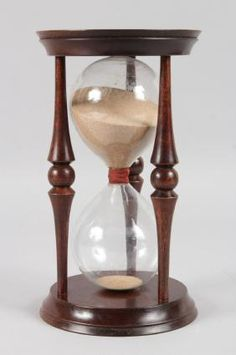 A LARGE HOUR GLASS.  9ins High.