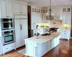 http://www.trendmarkinc.com/kitchen-remodeling - Custom Cabinets painted with espresso glazing and travertine countertops.