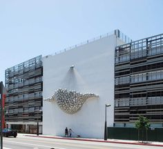 Santa Monica Parking Garage / Brooks  I was on my way to the beach one day and this building caught my attention. I love when they actually put in a little bit of effort into designing a parking structure.