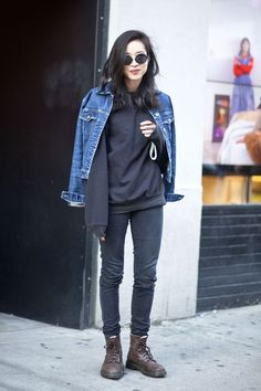 Denim jacket black sweatshirt black skinny jeans brown lace-up boots…