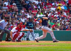 Dustin Ackley of the Seattle Mariners hits a 3run home run during the..