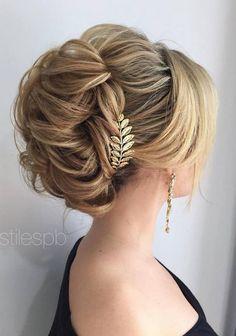 Stylish braided half-updo wedding hairstyle.