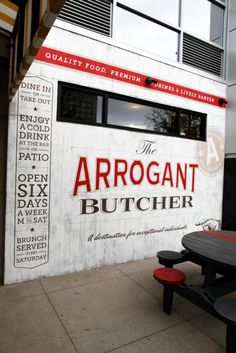 The Arrogant Butcher Wall Mural An identity and all the design & ad work for a new restaurant in downtown Phoenix, The Arrogant Butcher. Along with the logo, menus, uniforms & collateral TunnelBravo was given the chance to design the signage. The mural is one of the main features of the restaurant and has a prime location right next to the entrance.