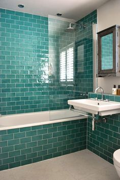 Have a look at how turquoise is used in these 8 homes #colour #turquoise #lbloggers #decor #hometones Bathroom tiled from floor to ceiling in turquoise subway tiles