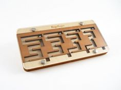 """Wooden Kugellager Puzzle: Slide the maze board back and forth to get the 4 steel marbles to the bottom. Made in Germany. 8.25 x 4 x .75""""  $49"""